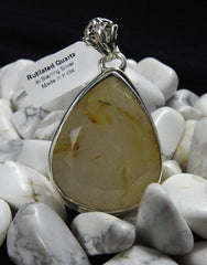 Rutilated Quartz pendant in howlite
