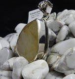 Rutilated Quartz pendant in white howlite