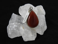 Carnelian pendant in sterling silver on clear quartz