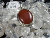 Carnelian pendant in sterling silver with Quartz