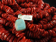 Sterling Silver pendant with a Larimar stone on red backdrop