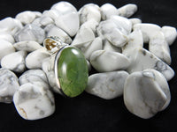 Prehnite stone on a black backdrop