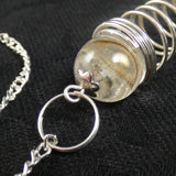 Clear Quartz Sphere and Terminated Point Pendulum