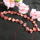 Mother of Pearl Red Pinched Bead Strand