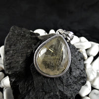 Faceted Rutilated Quartz in Sterling Silver Pendant (teardrop)