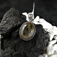 Faceted Rutilated Quartz in Sterling Silver Pendant (oval)