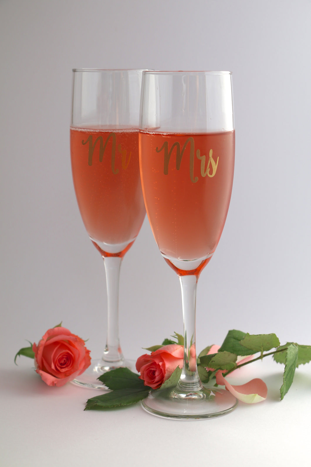 A pair of champagne flute glasses personalised with