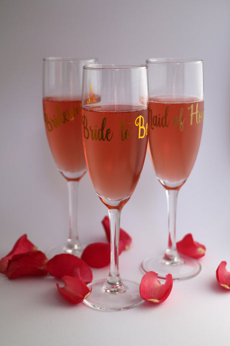 Personalised champagne glasses for the bride, groom, bridesmaids, groomsmen and more
