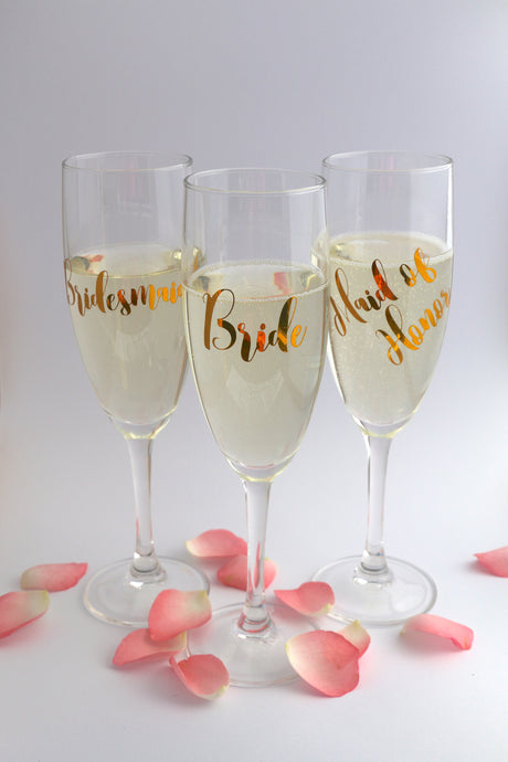 Personalised champagne flute glasses for the bride, maid of honor and bridesmaid