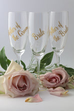 Personalised champagne glasses for the mother and fathers of the bride and groom