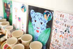 Ceramic dishes and mugs are hand painted and glazed by Emily Dolphin