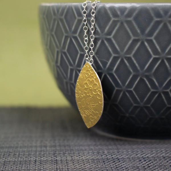 24k gold and silver flower patterned petal shaped pendant by Joanne Tinley Jewellery
