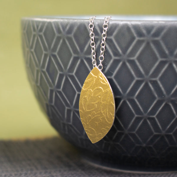 24k gold and silver oak leaf patterned petal shaped pendant by Joanne Tinley Jewellery