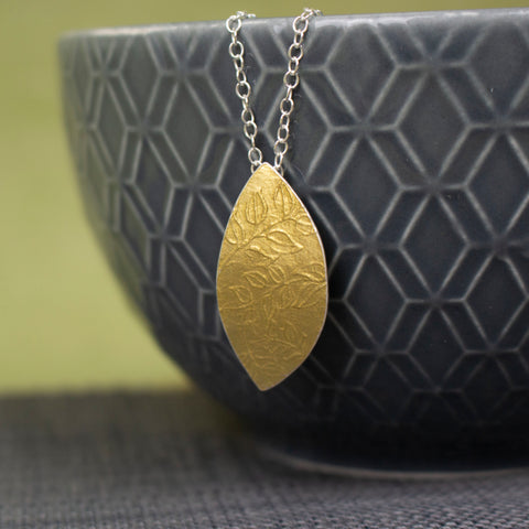 24k gold and silver leaf patterned petal shaped pendant by Joanne Tinley Jewellery