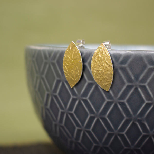 24k gold and silver oak leaf patterned petal shaped stud earrings by Joanne Tinley Jewellery