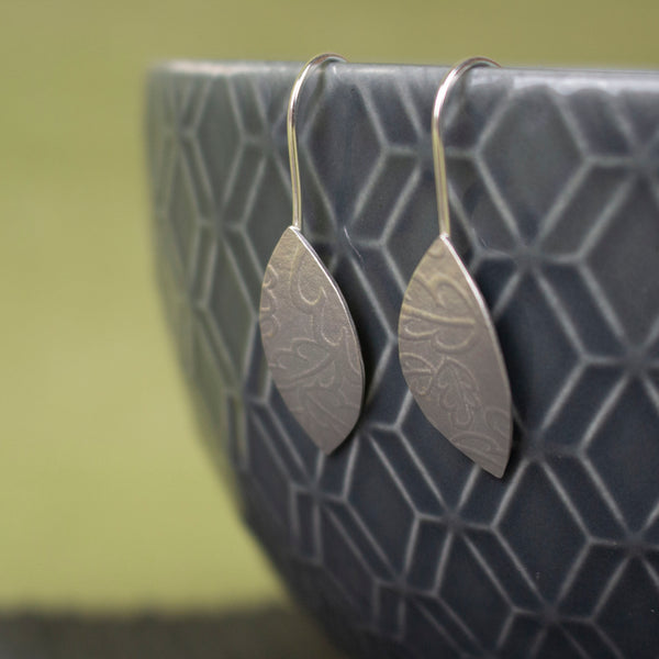 sterling silver petal shaped drop earrings by Joanne Tinley Jewellery