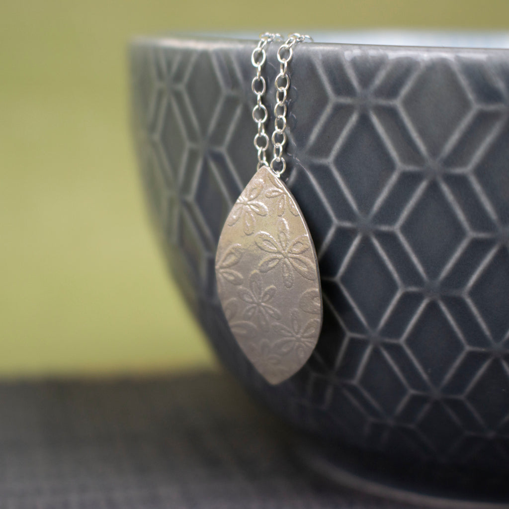 sterling silver petal shaped pendant by Joanne Tinley Jewellery