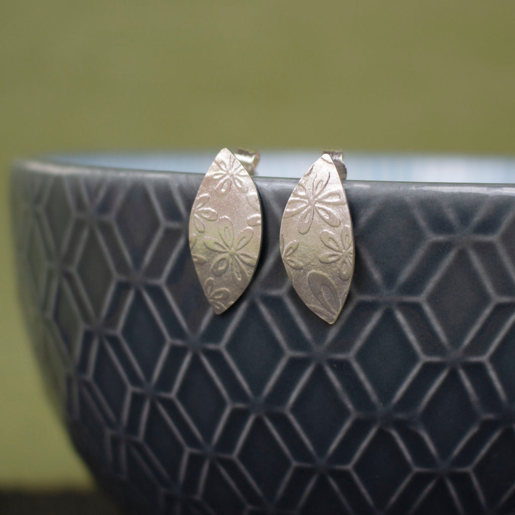 sterling silver petal shaped stud earrings by Joanne Tinley Jewellery
