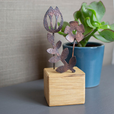 tulip,daisy and leaf ornament handcrafted from copper and oak by Joanne Tinley