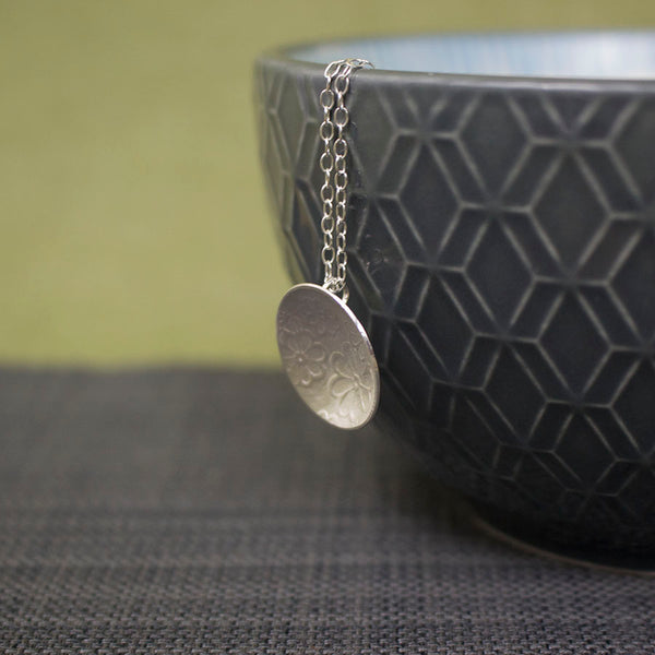 sterling silver flower disc pendant at Joanne Tinley Jewellery