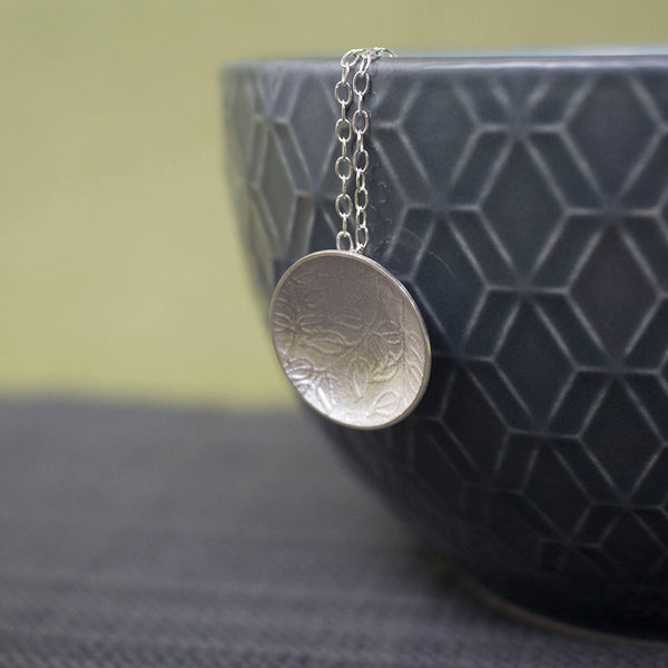 sterling silver leaves disc pendant at Joanne Tinley Jewellery