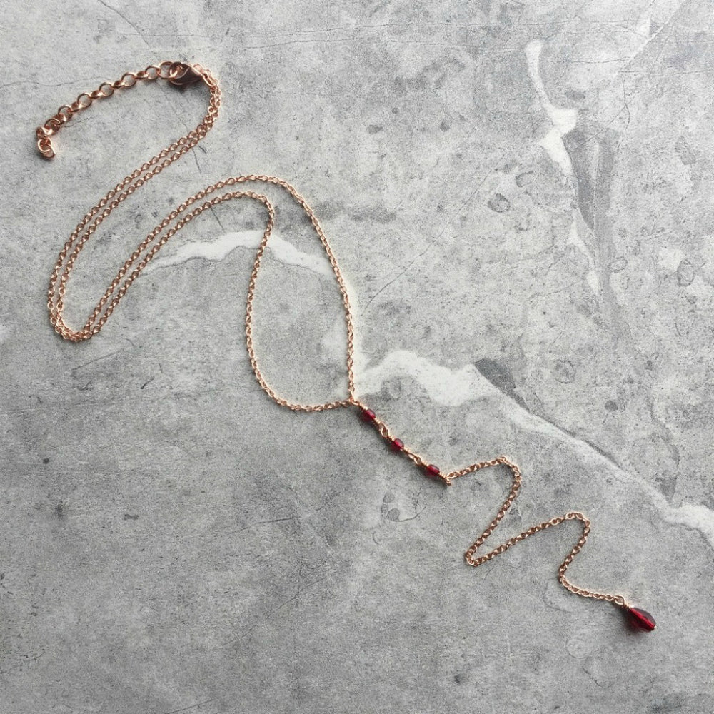 long delicate red crystal and copper chain lariat necklace