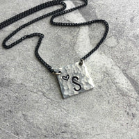 hammered silver square hand stamped initial necklace on delicate black chain