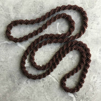 long continuous beaded crochet rope necklace in copper brown