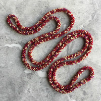 long continuous beaded crochet rope necklace in red and cream