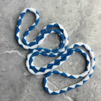 long continuous beaded crochet rope necklace in blue and white