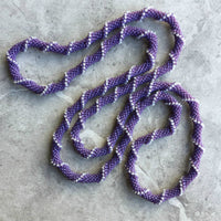 long continuous beaded crochet rope necklace in purple and white