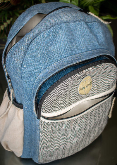 A hand-crafted hemp backpack made in Nepal by Pure World Brands. Lightweight backpack for travel, beach and hiking.