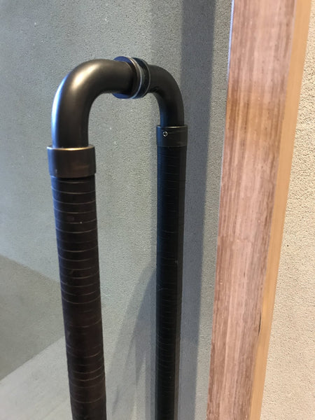 Spiral wrap leather entrance handle