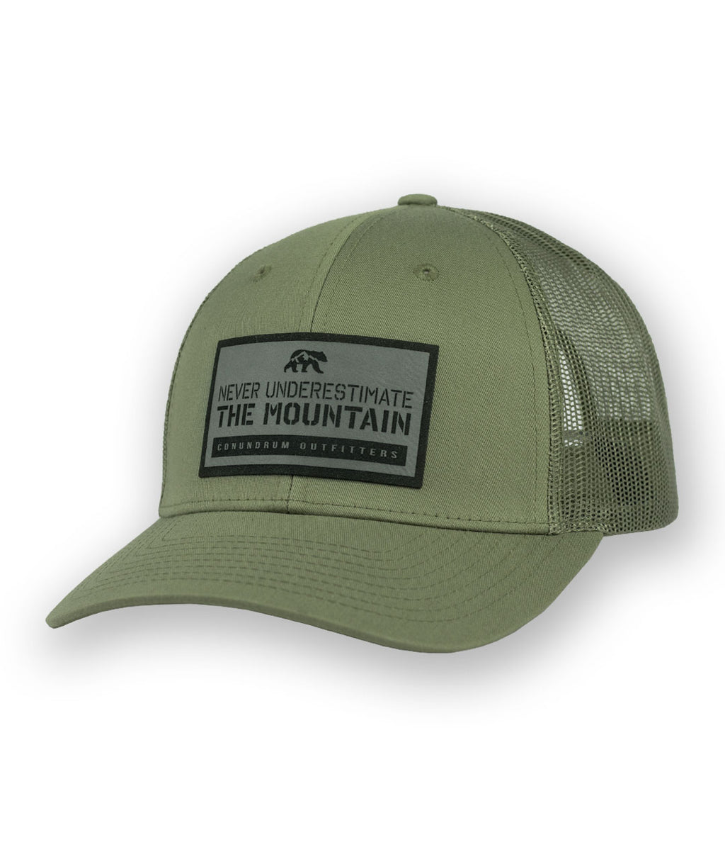 Never Underestimate the Mountain Loden Low Profile Trucker Hat