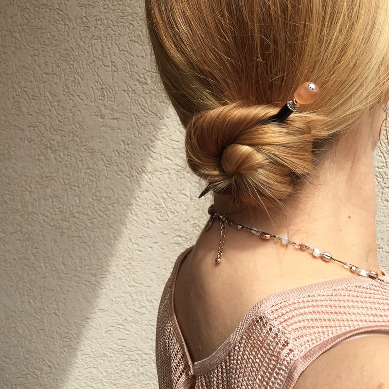 Tidal Hair Sticks Create an Elegant Low Hair Bun