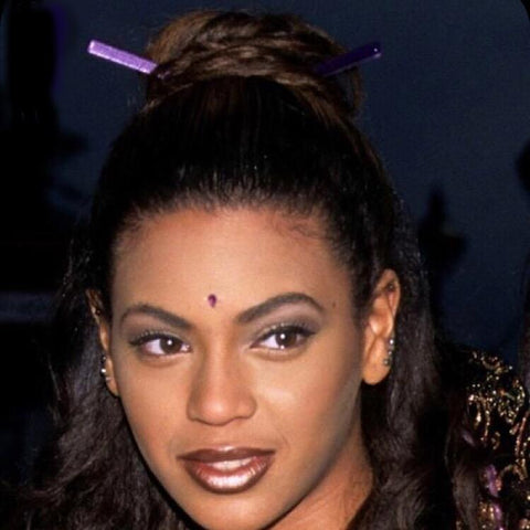 Beyonce circa 1999 wears a hair stick bun