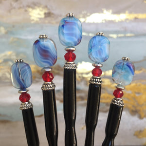 Five of the Charlotte Tidal Hair Stick made from red white and blue swirl glass beads