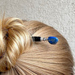 A woman wears one of our Chloe Tidal hair Sticks made from Lapis Lazuli Nuggets