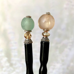 The two styles of Tidal Hair sticks that use African Recycled glass beads.