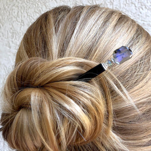 Blonde woman wearing one Dylan Hair Stick made from Labradorite stone