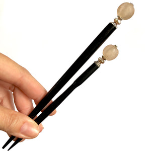 The standard and large sizes of the Ellen Hair Stick made from blush pink African Recycled Glass beads.