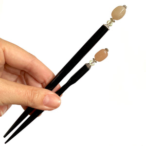 The standard and large sizes of the Farah Hair Sticks