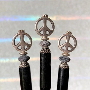 Three of the Freedom Tidal Hair Stick made from a silver peace sign and denim-colored accent bead.