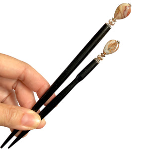 The standard and large sizes of the Gemma Hair Sticks