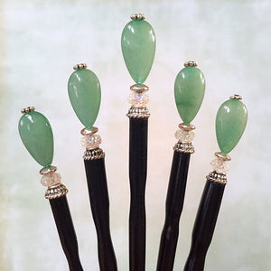 Five of the Joanna Tidal Hair Sticks made from aqua green aventurine stone beads