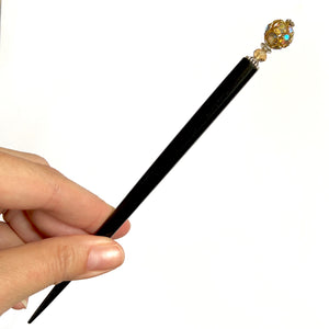 The large size of the Kathleen Hair Stick made from a gold Czech glass bead
