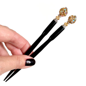 A pair of the Kathleen Hair Stick made from a gold Czech glass bead