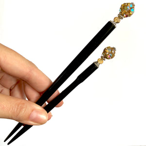 The standard and large sizes of the Kathleen Hair Stick made from a gold Czech glass bead