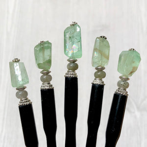 A group of five A close up of our Kira Tidal Hair Stick made from green fluorite nugget stone.
