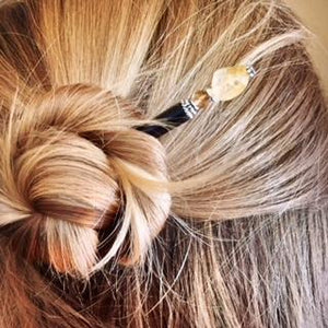 A woman wears a topknot using the Layla Hair Stick made from Yellow Citrine nugget beads.